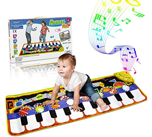 Dance mat in a form of piano keys with a baby on it. Gifts for children.