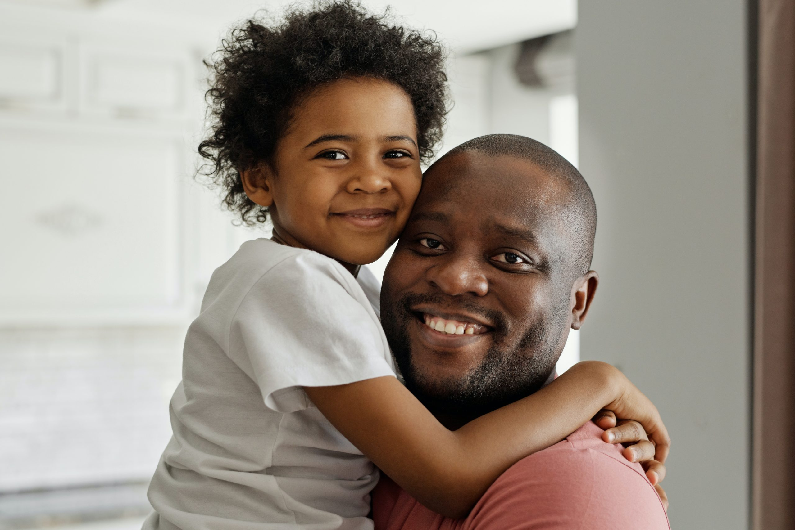Smiling girl and her father